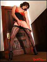 Leggy auburn-haired tranny in striped pantyhose