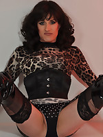 Cute TGirl tart dressed in a sexy leopard print outfit with thigh high boots as well.