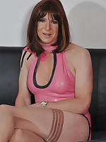 Sexy crossdresser dressed up in a gorgeous PVC outfit and looking very desirable.
