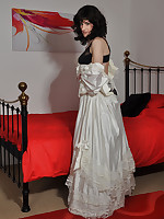 Sexy crossdresser wearing a long wedding dress and horny satin gloves.