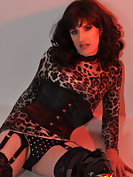 Sexy TGirl slut wearing a horny leopard print outfit.