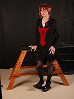 TGirl Lucimay is feeling a little bit gothic as she poses in her home made dungeon.
