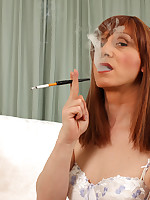 Lucimay uses her dick sucking lips to smoke a cigarette seductively.
