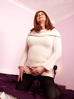 Lucimay slowly removes her mini skirt and shows off her hard cock.