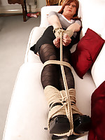 Lucimay pulls out her bag of toys and ropes and then gets herself tied up for some punishment.